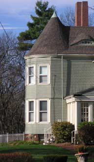 Two-story tower bay on a Shingle Style house