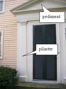 Door surround with pilaster and pediment on a Federal house