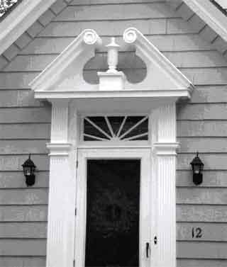 The pediment over this door is broken.