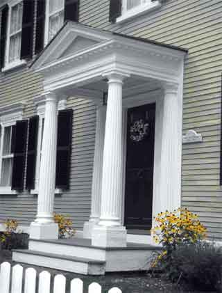 This portico is supported by columns and surmounted by a pediment.