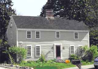 This side-gabled house has single central chimney.