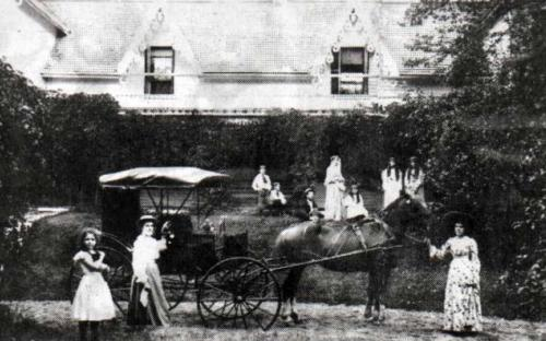 Downing Family in front of homestead circa 1890