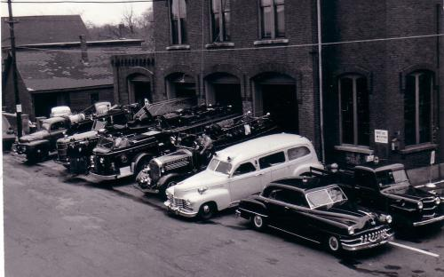 1950's with all the firehouse vehicles on display
