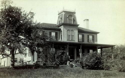 Circa 1900 with Franch Empire tower and porch