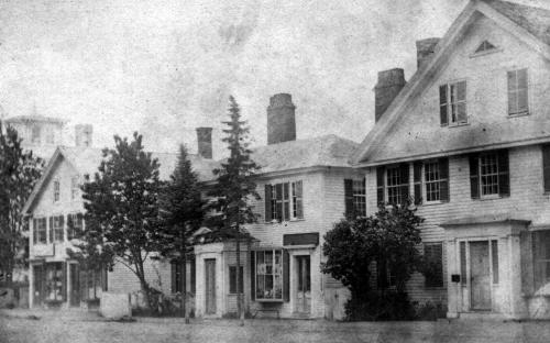 Circa 1866 – The center home once owned by Henry W. Abbott in 1840-1868 became Draper's book store in 1870. M. L. Ramsdell had his confectionary & fancy goods store pictured here with the bay window. Jan. 3, 1864 - M. L. Ramsdell – Stationary, Fancy Goods, Confectionary, opposite Town Hall.
