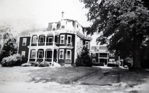1975 with mansard roof and two story porches
