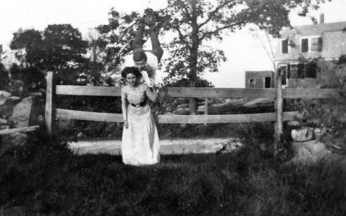 Mabel Bailey in front of fence, perhaps Anton Bailey behind.