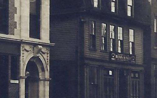 detail of large photo showing the original John Cornell building 1911