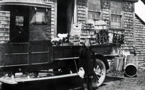 Plant house - Mary Rennie in front of truck circa 1920
