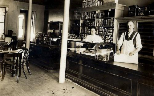 J. P. West at store counter - 1904-1910