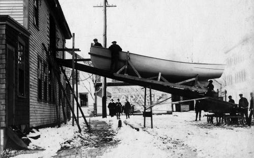 Boat on Bartlet St. being lowered out?  c. 1912