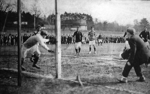 "The old ""Cricket Field"" with soccer match. Gas tank in background"