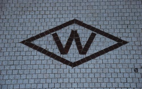 Aug. 2011 - Woolworth's logo in doorway apron.