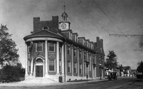 Post Office Building 1920 with Shawsheen Market to rear next to car.