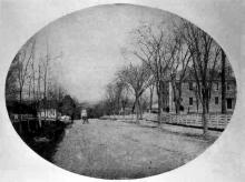 Stone Academy building on right, Main Street c. 1860